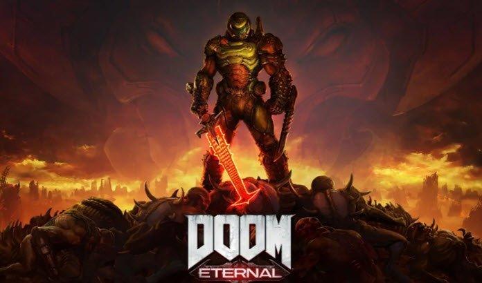 Un hombre con armadura completa y una espada flamígera, parado sobre un promontorio y a su alrededor ruge el fuego donde se lee la leyenda DOOM Eternal.