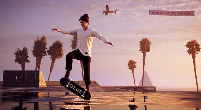 Una joven delgada con gorro vestida con sudadera blanca y pantalón negro haciendo una pirueta con una patineta sobre un piso de mosaicos beige y al fondo tres palmeras frondosas, una pirámide y un avión volando y llevando una pancarta que dice en ingles lava tus manos