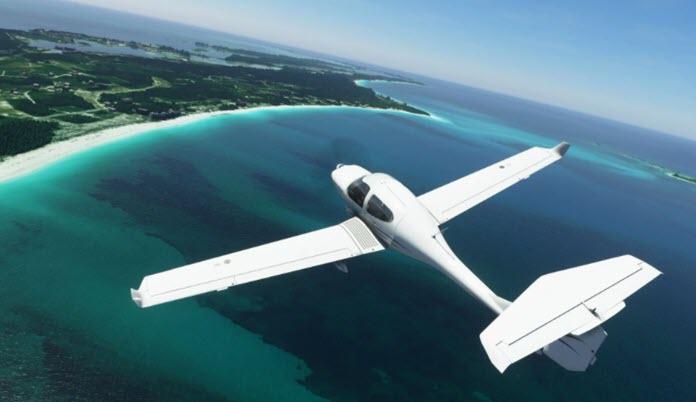 Vista de Microsoft Flight Simulator con una avioneta sobrevolando una isla