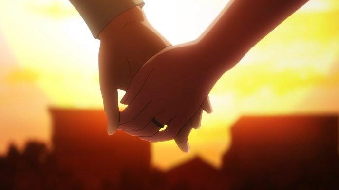 Imagen del anime Tonikawa con un primer plano de las manos entrelazadas de los protagonis mientras al fondo se ve el atardecer.