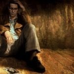 Harry Mason, protagonista de Silent Hill: Shattered Memories sentado en una habitación oscura
