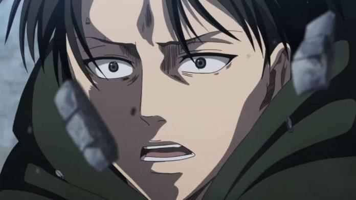 Imagen tomada del anime 'Shingeki no Kyojin' con un primer plano de Levi mientras piedras flotan frente a sus rostro.