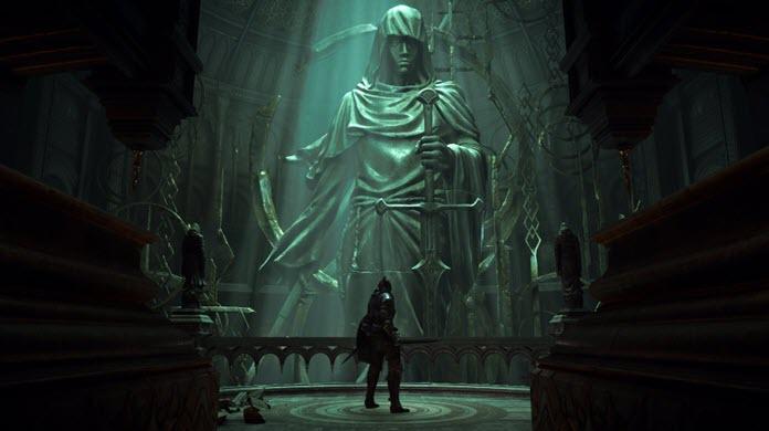 Protagonista de Demon's Souls frente a una enorme estatua