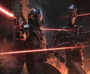 Protagonista de The Mandalorian al lado de un droide en pleno enfrentamiento con blasters