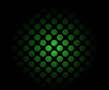 Parte del logo de xbox de color verde en el fondo negro