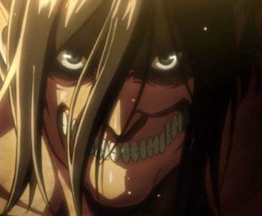 Imagen tomada del anime de 'Shingeki no Kyojin' con Eren transformado en Titan en un primer plano.