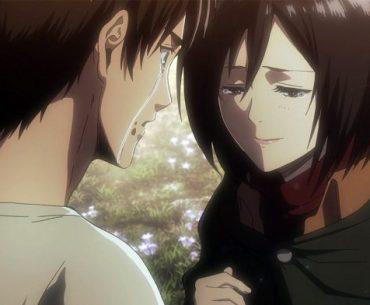 Imagen tomada de 'Shingeki no Kyojin' con eren de espaldas mientras una lágrima recorre su mejilla y mira a Mikasa con una sonrisa triste.