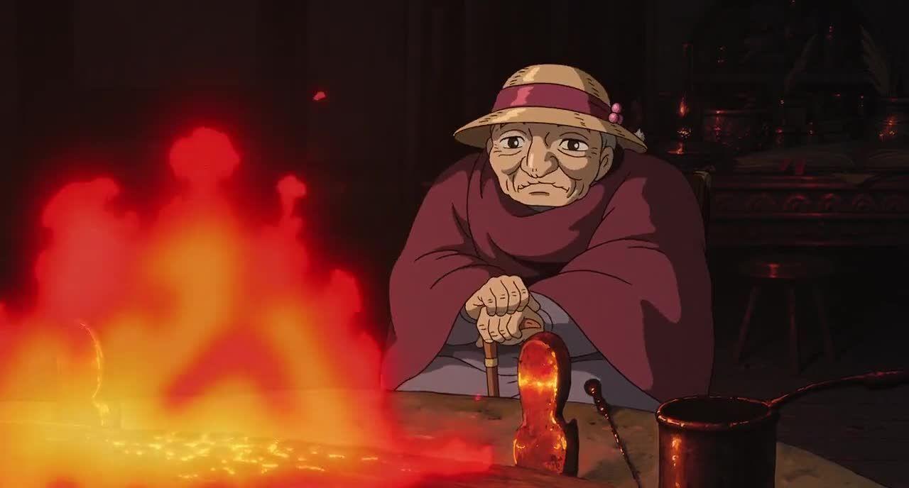 Imagen tomada de la película 'El castillo ambulante' con la protagonista frente a una fogata.