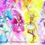 Imagen promocional de 'Healin' Good♡Precure Movie: Yume no Machi de Kyun! Tto GoGo! Dai Henshin!!' con las protagonistas en pose de batalla con un arcoiris de luces al fondo