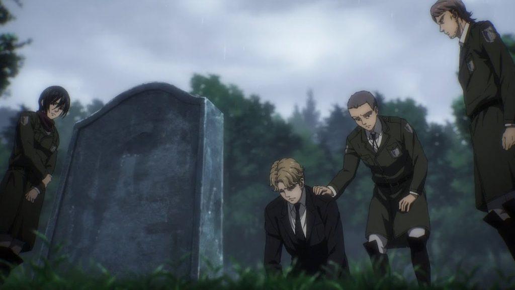 Imagen tomada del episodio 09 de 'Shingeki no Kyojin The Final Season' con varios de los personajes principales reunidos en el funeral y frente a la lápida.