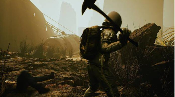 Un hombre sostiene una pala en un páramo desierto
