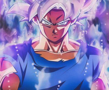 Imagen de Goku en 'Dragon Ball Super' cubierto de un ahora azul y violeta con expresión decidida.