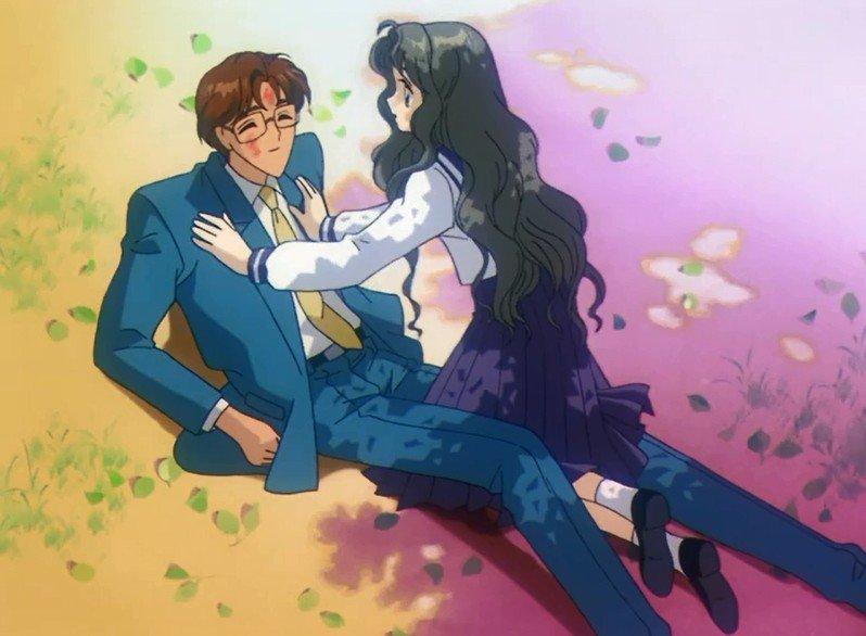 Imagen tomada del anime 'Card Captor Sakura' con la madre de Sakura en su juventud en el regaso de su padre.