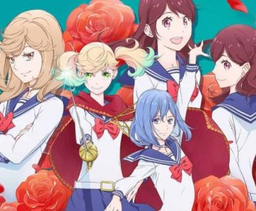 Imagen promocional de 'Kageki Shoujo!!' con las protagonistas posando frente a la.camafa en un fondo verde cubierto de rosas.