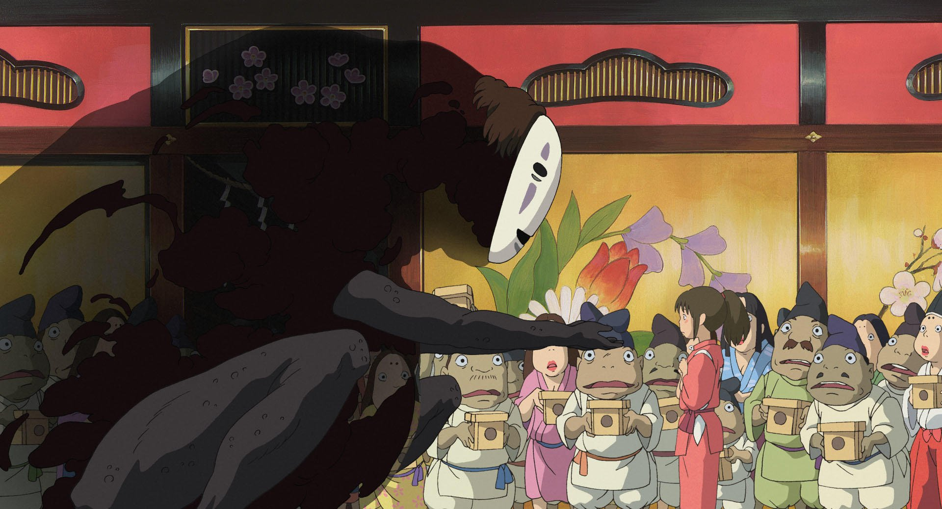 Imagen tomada de 'Sen to Chihiro no Kamikakushi' con el.sin rostro ofreciéndole comida oro a Chihiro.
