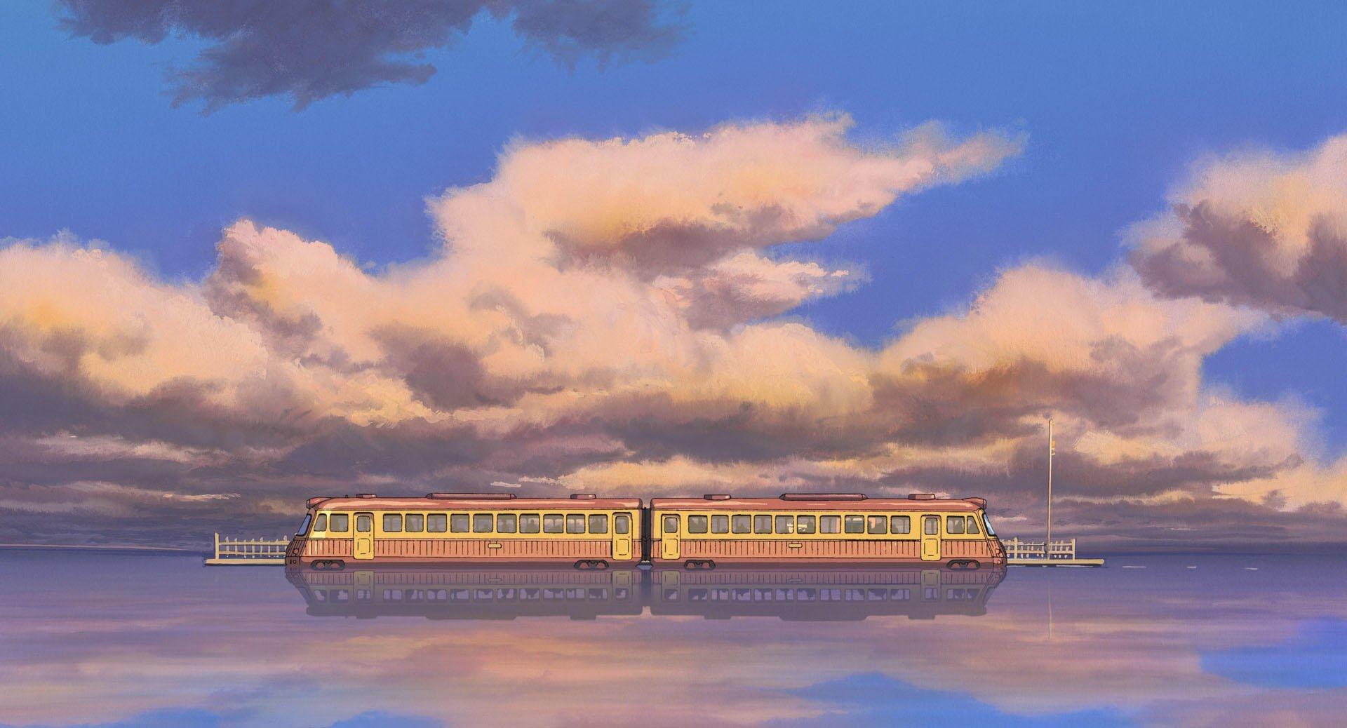 Imagen tomada de 'Sen to Chihiro no Kamikakushi' con un plano lejano del tren que lllleva a Chihiro y sus amigos hasta la casa de la.hermna de Yubaba.