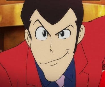 Imagen tomada de la quinta parte de 'Lupin III' con un primer plano del protagonista sonriendo a la cámara.